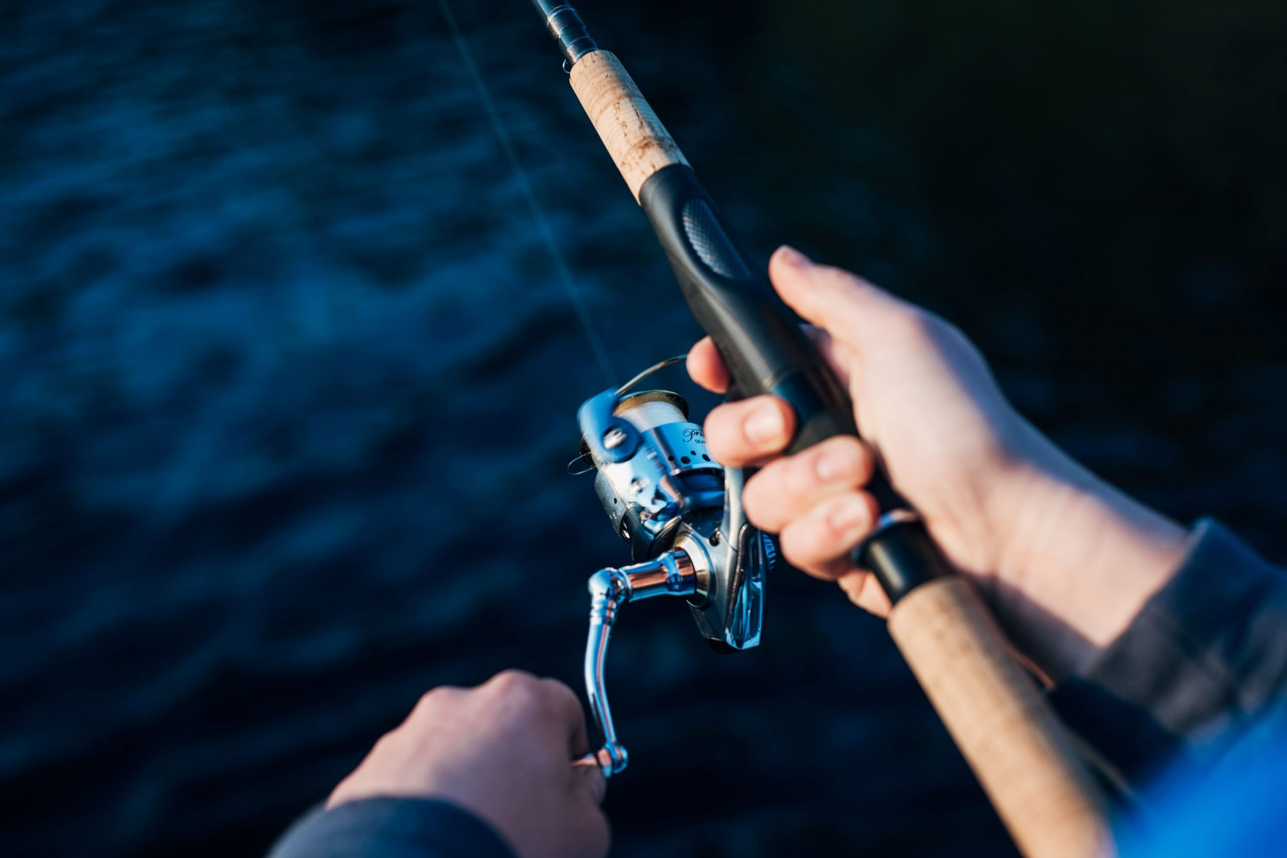 photo-of-person-holding-fishing-rod-2473502